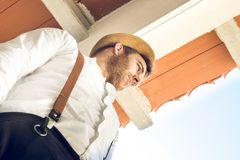Portrait of a guy with a hat and suspenders stock photos