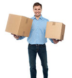Portrait of a guy holding boxes Royalty Free Stock Photos