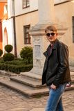 Portrait of a guy in round sunglasses and leather jacket. In Europe town stock photos