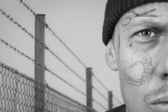 Portrait of guy with teardrop and prison face tattoo. Portrait of guy with teardrop and face tattoo. Criminal, convict and prison tattoos concept. Image montage stock images