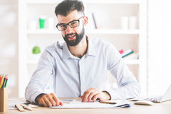 Portrait of guy at workplace Stock Images