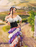 Gypsy girl. Portrait of Gypsy girl with Andalusian landscape stock images