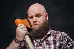A man shaving with an axe. Stock Images