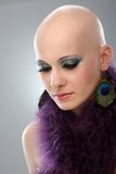 Portrait of hairless woman in purple boa. Beauty portrait of hairless woman in purple boa Royalty Free Stock Photography