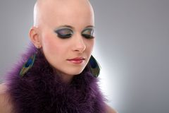 Portrait of hairless woman in purple boa. Beauty portrait of hairless woman in purple boa Royalty Free Stock Photo