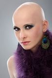 Portrait of hairless woman in purple boa. Beauty portrait of hairless woman in purple boa, looking at camera Royalty Free Stock Image