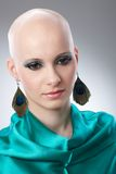 Portrait of hairless woman in turquoise silk dress Royalty Free Stock Images