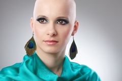 Portrait of hairless woman in turquoise silk dress. Beauty portrait of bald woman in turquoise silk dress Stock Images