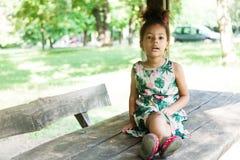 Portrait of half-caste children in park Royalty Free Stock Photos