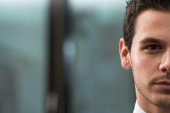 Portrait Half Of Face Of Young Businessman Royalty Free Stock Photo