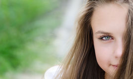 Portrait half face young woman. stock photo