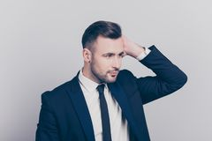Portrait of half turned stunning ideal boss touching his hair lo royalty free stock images