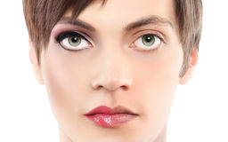 Portrait half woman half man, androgyny concept. In white background royalty free stock image