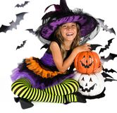 Halloween kids, Happy scary girl dressed up in halloween costumes of witch, sorcerer and vampire Dracula for pumpkin patch. Portrait of a Halloween kids, Happy royalty free stock photos