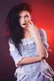 Portrait of halloween vampire woman aristocrat with stage makeup Stock Photos