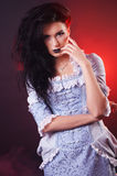 Portrait of halloween vampire woman aristocrat with stage makeup Royalty Free Stock Images