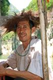 Han chinese fisherman with traditional hat. Portrait of a Han chinese man with the traditional hat of the fishermen at yangtze river made of nature material Royalty Free Stock Photos