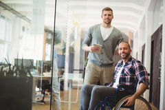 Portrait of handicap businessman with colleague in office Royalty Free Stock Image
