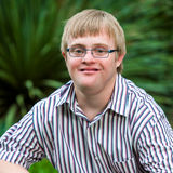 Portrait of handicapped boy wearing glasses. Royalty Free Stock Photography