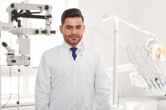 Professional dentist at his clinic royalty free stock image