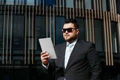 Portrait of handsome adult business man reads news Royalty Free Stock Images