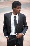 Portrait of a handsome african american fashion model in black suit Royalty Free Stock Photo