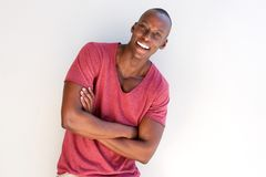 Handsome african man smiling by white background. Portrait of handsome african man smiling by white background Royalty Free Stock Photo