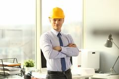 Portrait of Handsome Architect Builder at Office. Man in Formal Shirt and Yellow Helmet Working with Documents on Construction Site. Safety Constracting stock photo