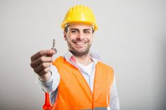 Portrait of handsome architect holding house key royalty free stock photography