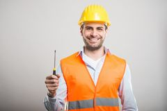 Portrait of handsome architect holding one screwdriver Stock Photos