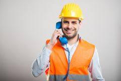 Portrait of handsome architect talking at telephone stock image