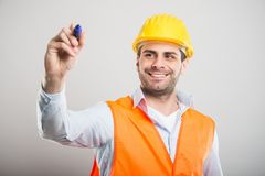 Portrait of handsome architect writing with blue marker Stock Photo