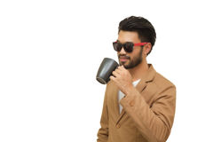 Portrait of a handsome asian young businessman drinking coffee. Isolated on white background Royalty Free Stock Image
