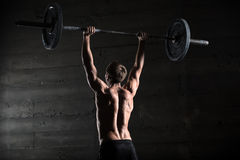 Portrait of a handsome athlete from behind Royalty Free Stock Photos