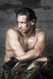 Portrait of handsome athlete. Portrait of handsome long hair muscle athlete on wall background Royalty Free Stock Photography