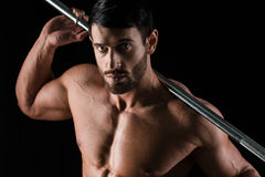 Portrait of a handsome athletic man holding barbell Royalty Free Stock Photography