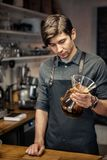 Barista Cafe Making Coffee Preparation Service Concept. Portrait of a handsome barista making a cup of coffee at the coffee shop Stock Images
