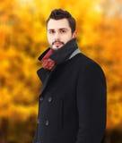 Portrait handsome bearded brunette man wearing a black coat in autumn day stock image