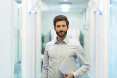 Portrait of handsome bearded business man in corridor office. lo Royalty Free Stock Images
