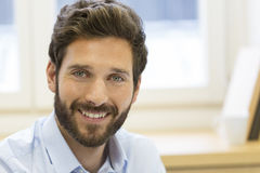 Portrait of handsome bearded man in office. looking camera stock photo