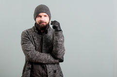 Portrait of handsome bearded  man wearing black leather gloves. Isolated on grey background Stock Image