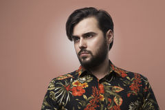 Portrait Handsome Bearded Man Wearing Stylish Color Shirt.Beauty,Lifestyle,People Concept Photo.Adult Serious Hipster. Guy Empty Bronze Background.Horizontal Royalty Free Stock Images