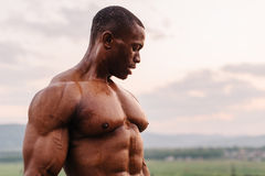 Portrait of handsome black african american bodybuilder on the sunrise sky background Royalty Free Stock Photos