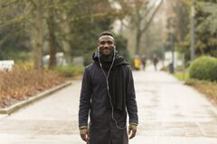 Portrait of Handsome Black Man Posing in Autumnal Park