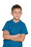 Handsome boy in blue striped shirt Stock Images
