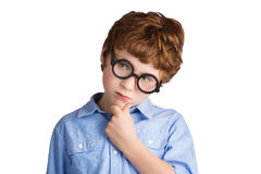Portrait of handsome boy in round glasses thinking Royalty Free Stock Image