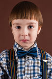 Portrait handsome boy in shirt with bow tie Royalty Free Stock Photos