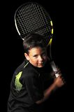 Portrait of handsome boy with tennis equipment Royalty Free Stock Photos