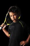 Portrait of handsome boy with tennis equipment Stock Photography