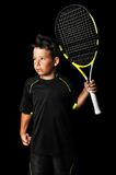 Portrait of handsome boy with tennis equipment Royalty Free Stock Images